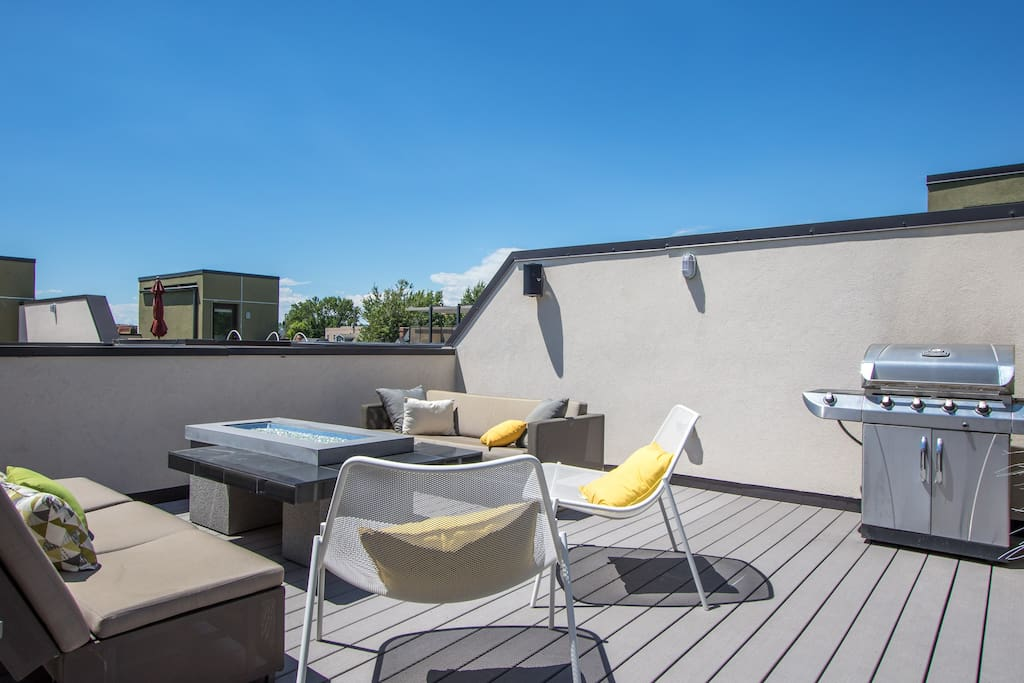 The private rooftop deck with grill, firepit, a couch, a day bed, and many chairs is always a favorite of my guests.  Four outdoor speakers provide guests ability to play music outside as well (remember to please respect the neighbors!)