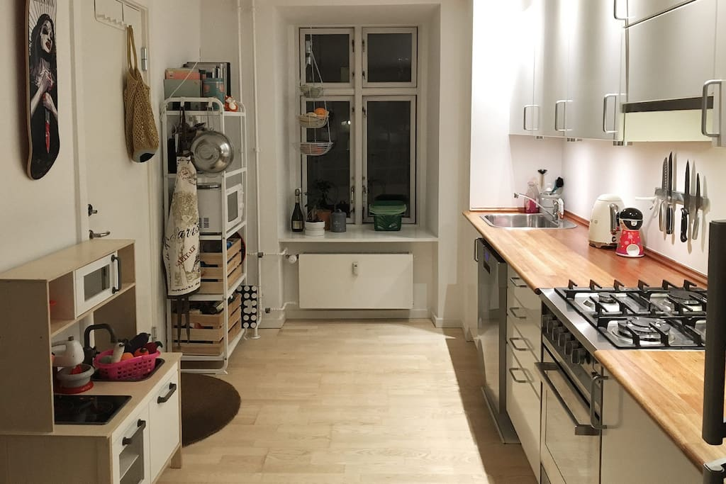 Fully functional kitchen with gas stove, microwave oven and even a play kitchen