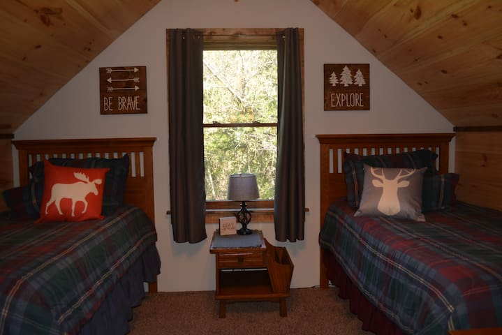 Bedroom 2 on the north end of the second floor includes two twin beds, providing sleeping space for 2 people
