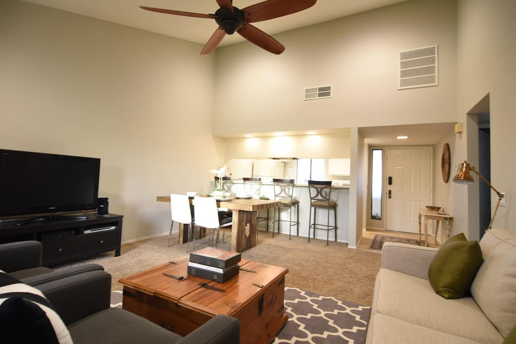 Larger wooden paddled ceiling fan and queen sleeper sofa.