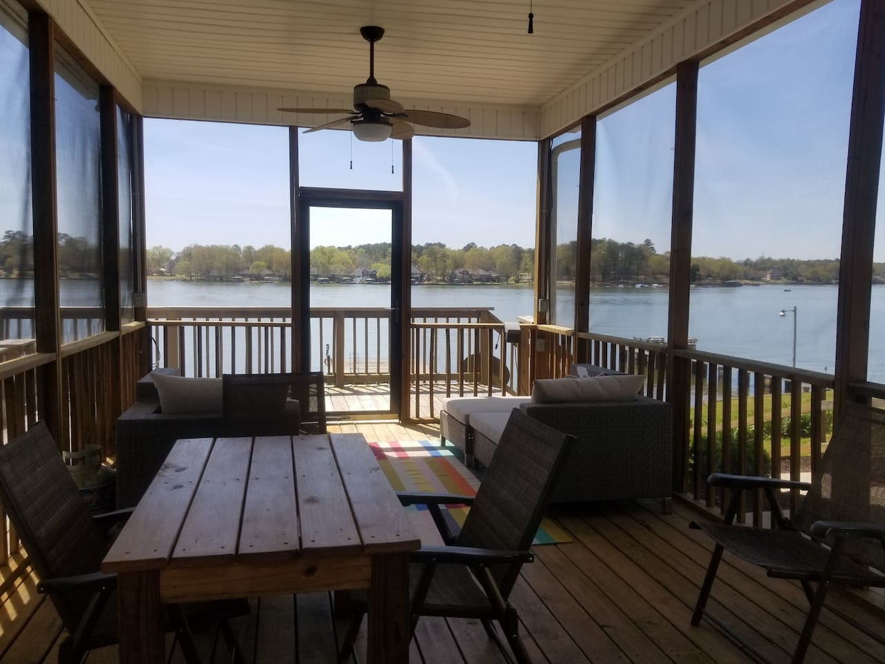 Large screened porch with fans and lighting