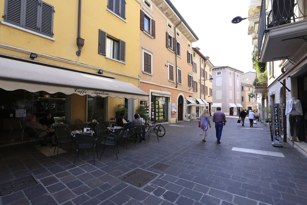 Pedestrial main road with shops and restaurants right in the historical center.