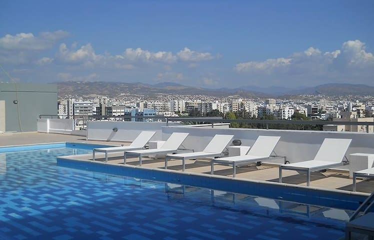 Rooftop swimming pool, just few steps away :)