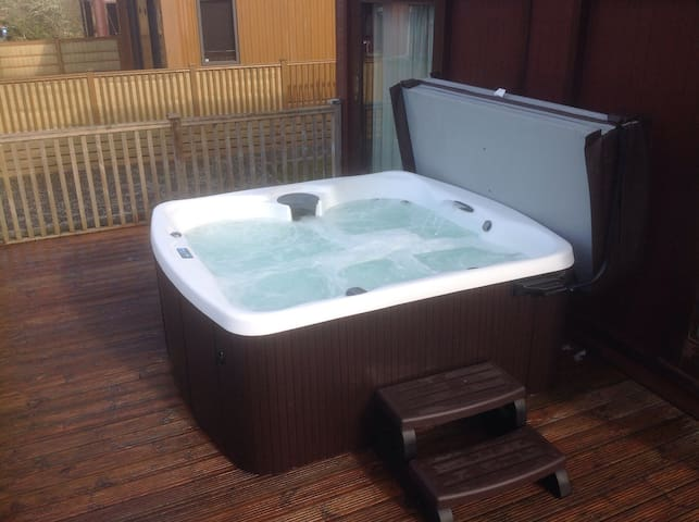Private 6 person hot tub on the deck.