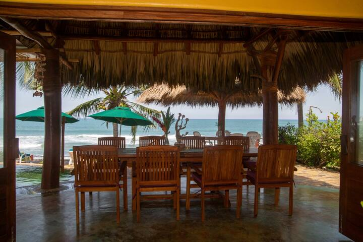 Outdoor Dining Table with Palapa Table Behind