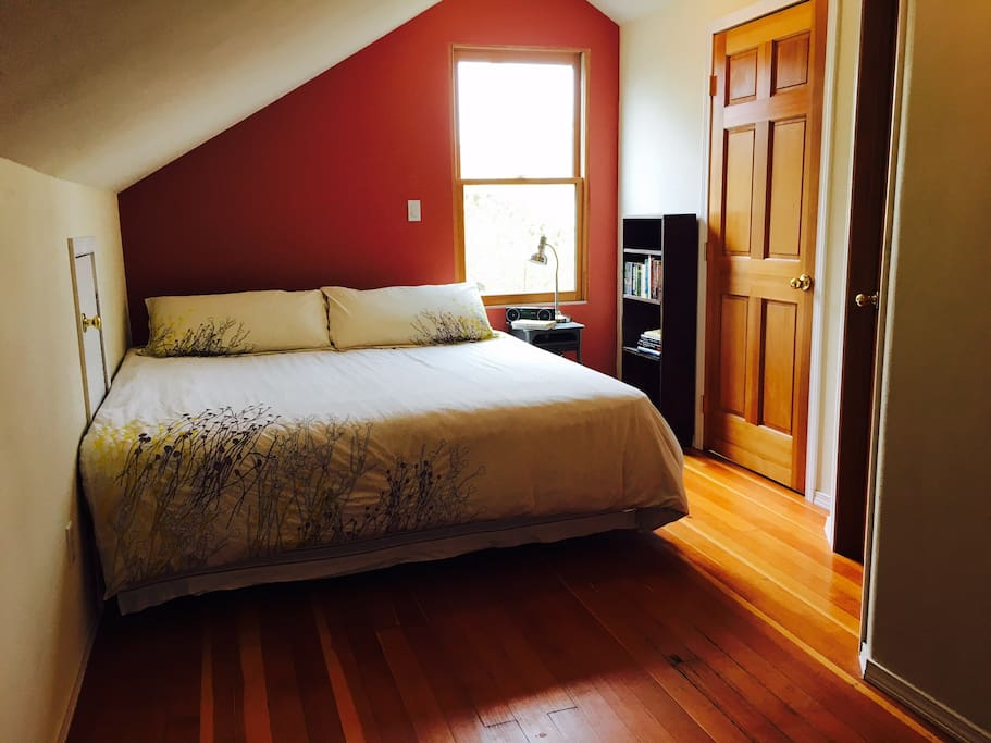 The master bedroom in our converted attic has a king size bed and a bathroom with a shower.