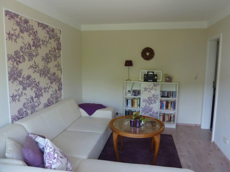Wohnzimmer mit Sc hlafsofa für den 3. Gast