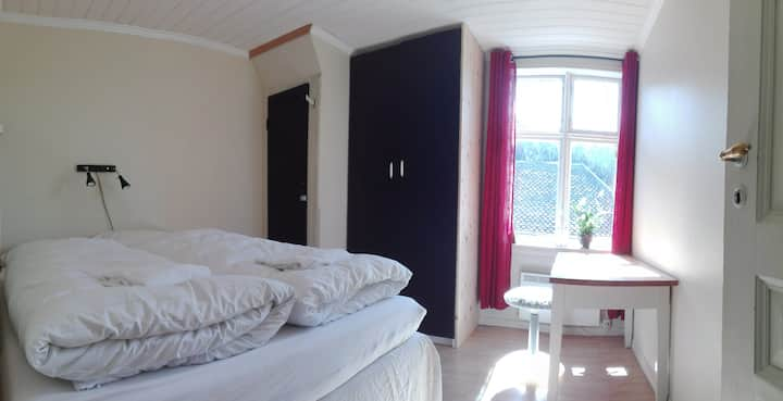A room for two in a friendly family home near Voss