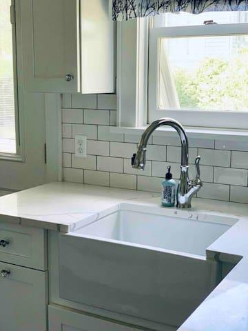 Fully renovated bright sparkling white kitchen
