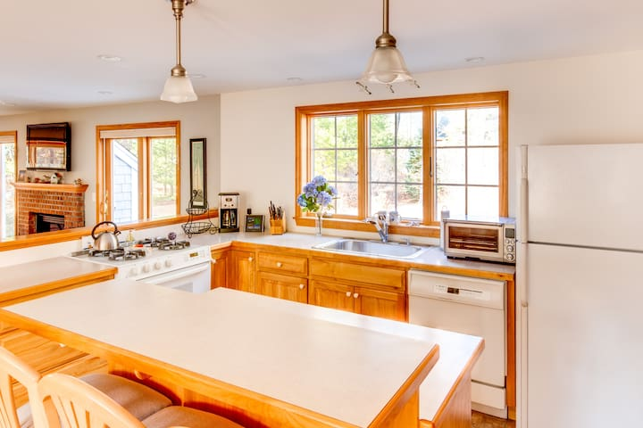 Fully stocked kitchen with ample room and great sunlight.