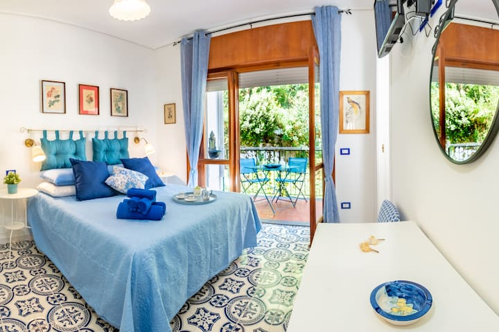 Bedroom 1 - Queen Sized Bed with Fresh Linens, En-suite Bathroom with Shower, Clean Towels and Complimentary Toiletries Provided, Access to outside Terrace area, Clean Towels Included, Air Conditioning, Free Wi-Fi 24hrs, Satellite TV