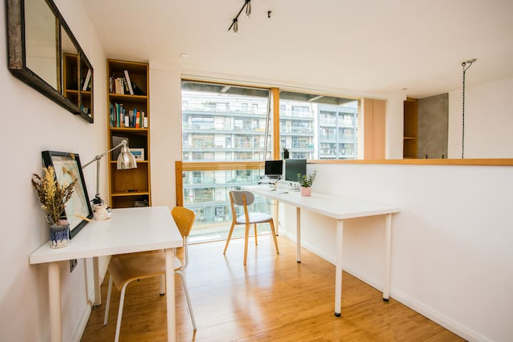The upstairs workspace overlooking the canal