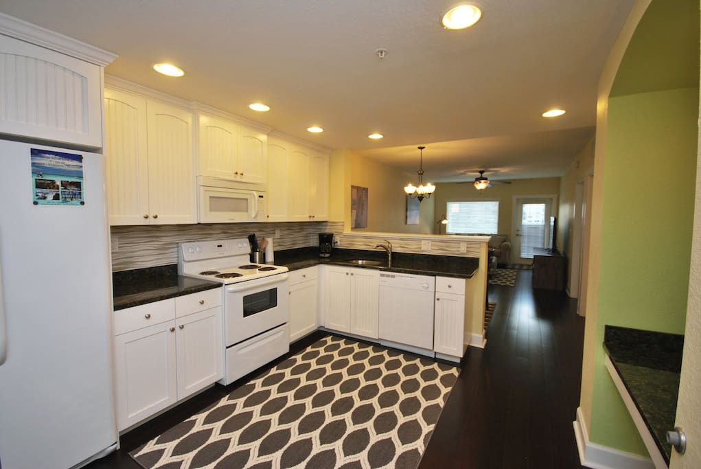 Kitchen - Fully equipped with plates, pots, pans, silverware, coffee maker and more.