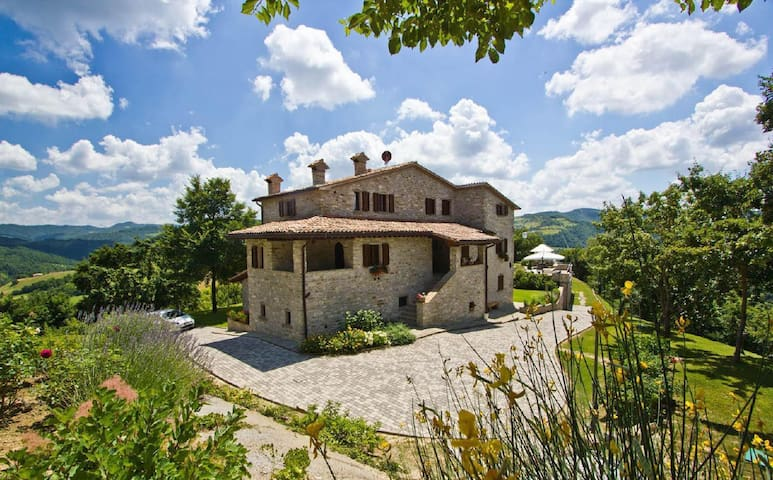 Beautifully designed and spacious holiday apartment in a beautiful stone house with pool
