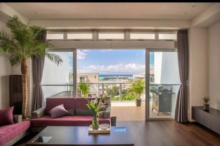 沖縄最大16人まで追加料金無し5ベットルーム4シャワールーム3トイレBBQジェットバス海の眺め最高