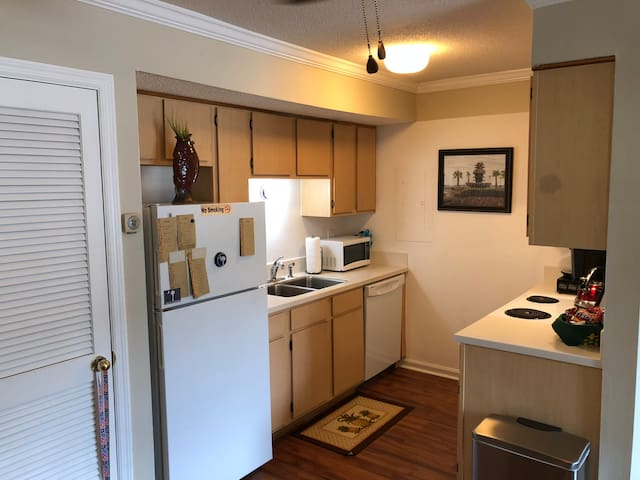 Kitchen with Microwave, Toaster, and Toaster Oven. Kitchen is Fully Stocked Glassware, Dishes, Utensils, Etc.