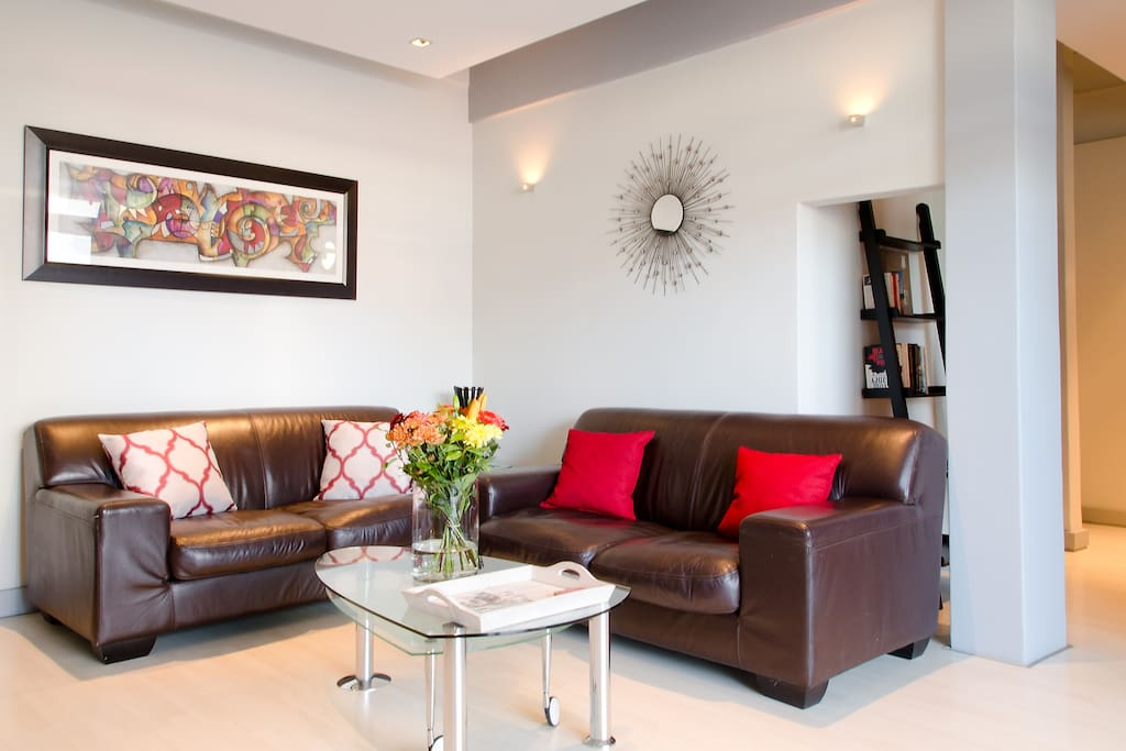 comfortable leather couches in light filled lounge