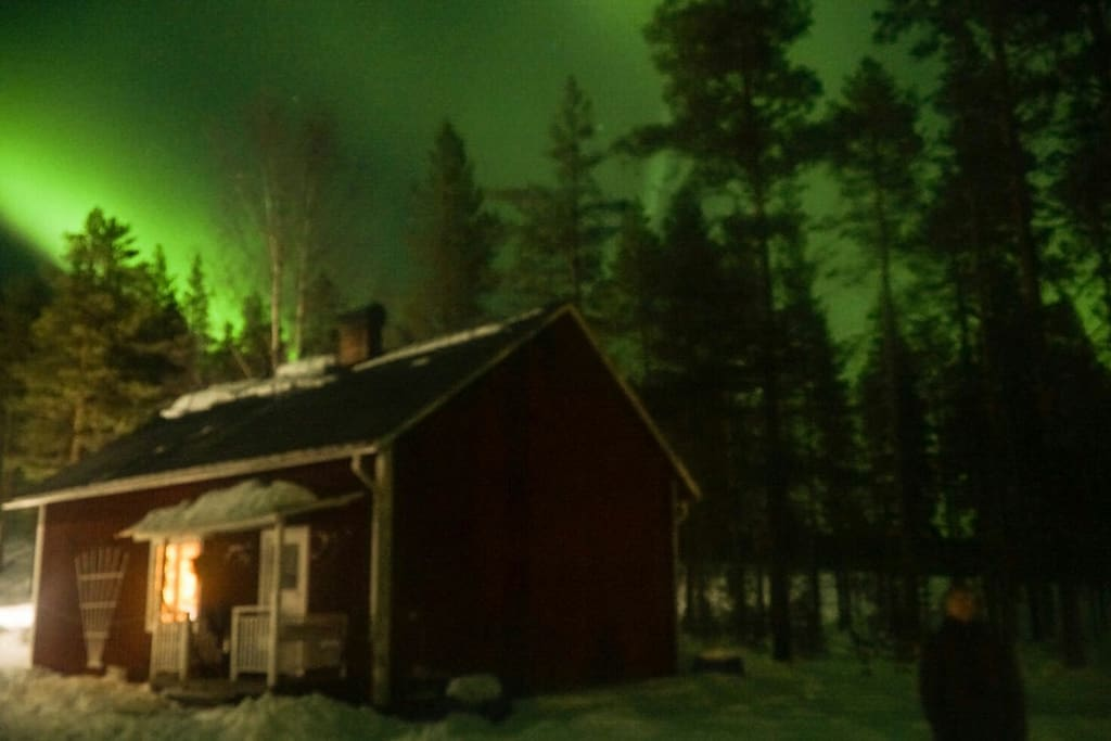 Winter Cabin with Northern Lights magic