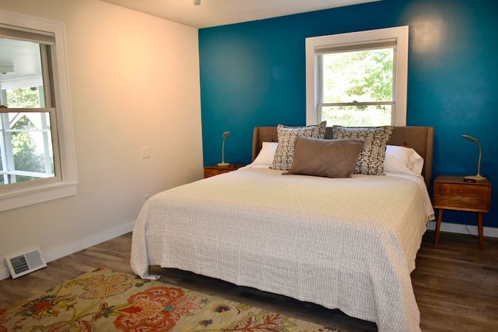 King Size Bed - There are double closets in this room and a chest of drawers. Every room in the house has overhead lights with dimmers.