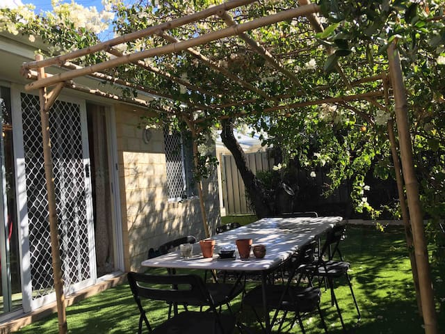 Pergola & dining table in the beautiful front yard