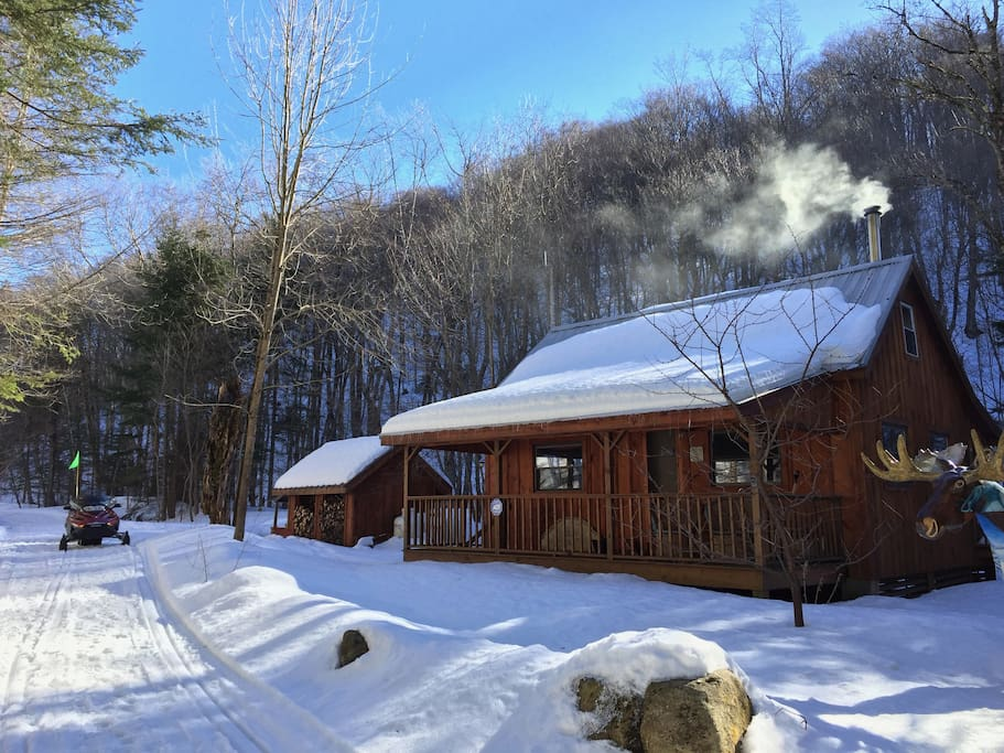 Winter view of Stone's Camp: a restored 1930's lumberjack camp.