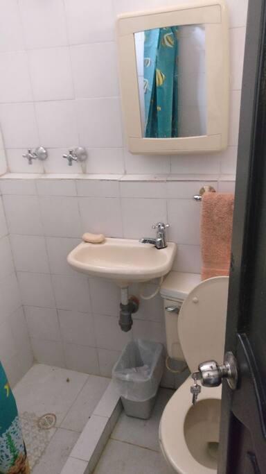 Baño privado en una habitacion