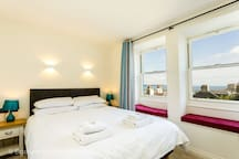 King size en-suite bedroom with views of the bay