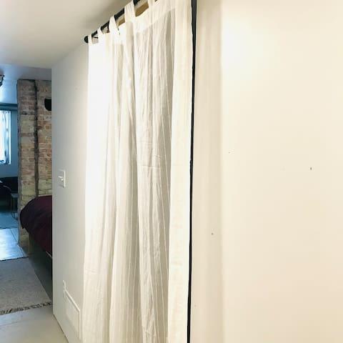 Doorway to bedroom with twin bed