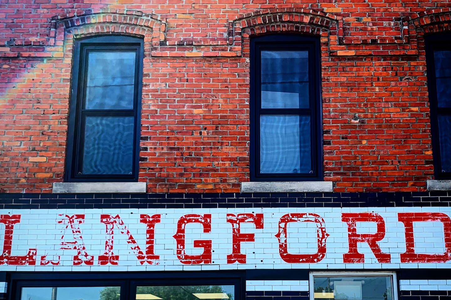 Salvaged sign on historic Harrow building