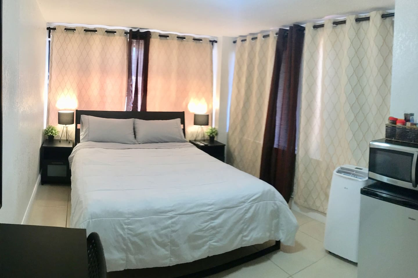 Queen Bed, sitting area, AC unit small refrigerator, microwave and a kettle