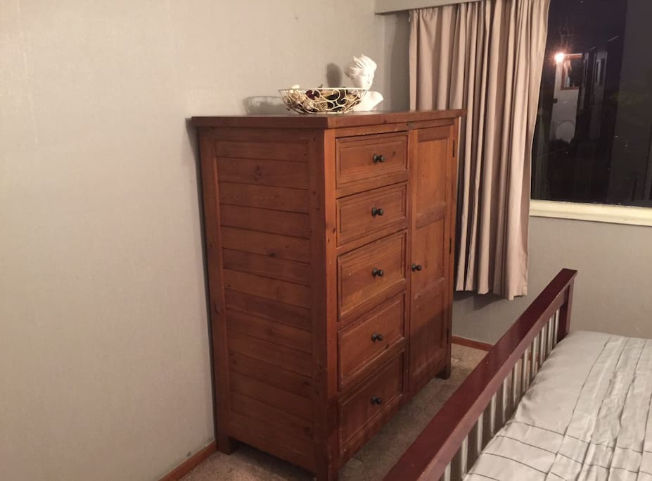 Your room with a large wooden chest of drawers