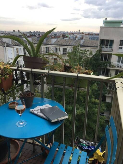 Enjoy a glass of wine over Paris ...