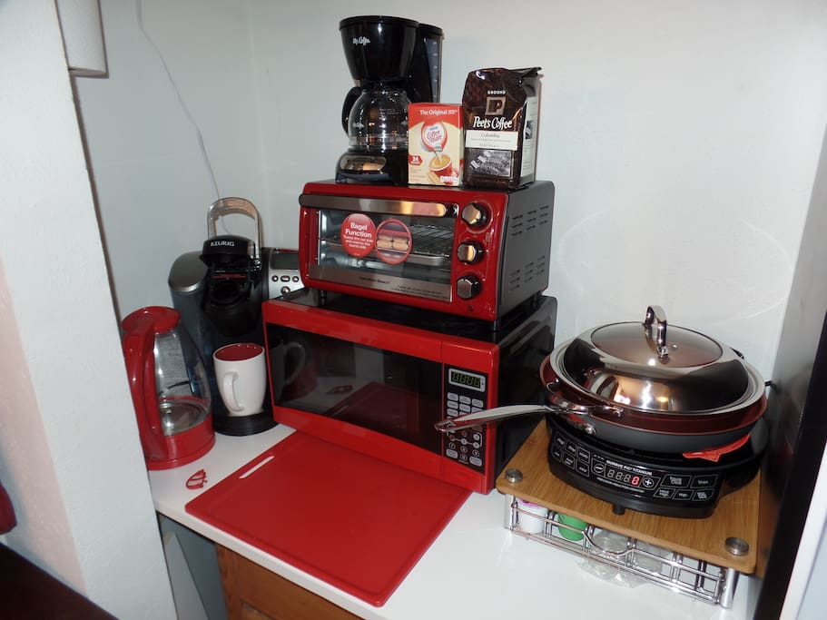Full kitchenette w mini-fridge, micro-wave oven, toaster oven, induction cooking plate, rice cooker, regular coffee maker, Keurig K-cup coffee machine and hot water boiler.