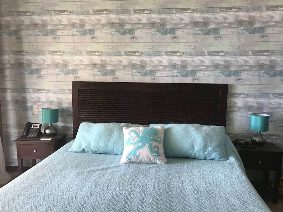 Master bedroom, king size bed, beach feel, view of ocean and beach, opens to the terrace