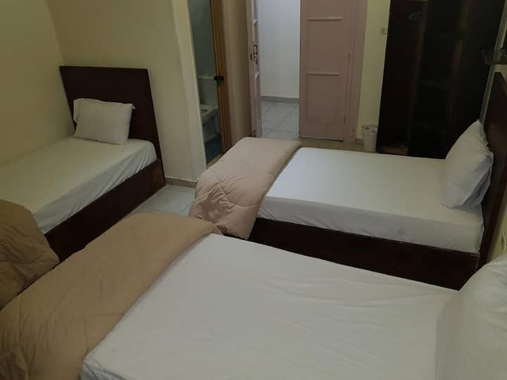3 single beds private room with private Bathroom