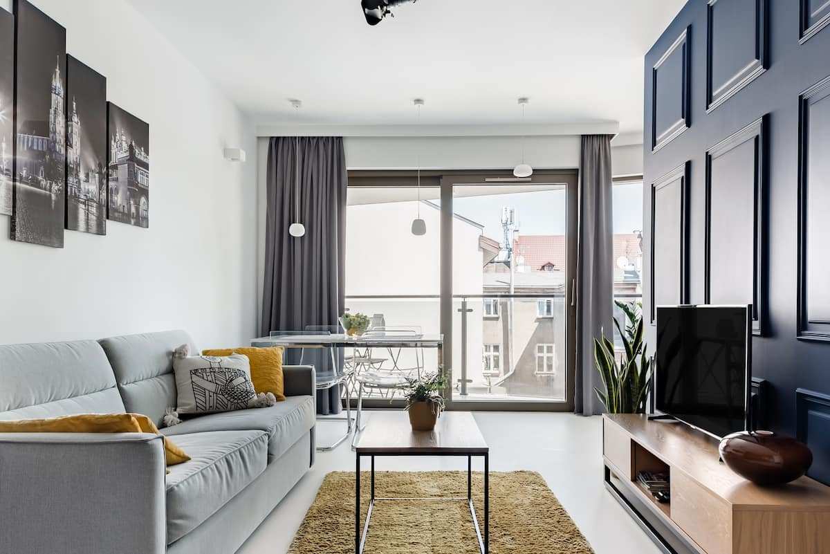 Admire the Chic Vibe of a City Pad with Paneling and Perspex