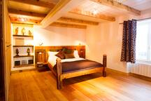 The Master bedroom is warm, cosy and infused with relaxing warm lighting