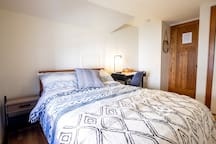 The room has everything you'll need for your stay - a place to relax, a place to work, and a place to get some rest.