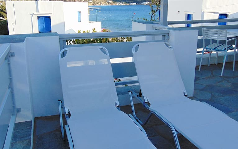 Lounge chairs in the terrace of the apartment