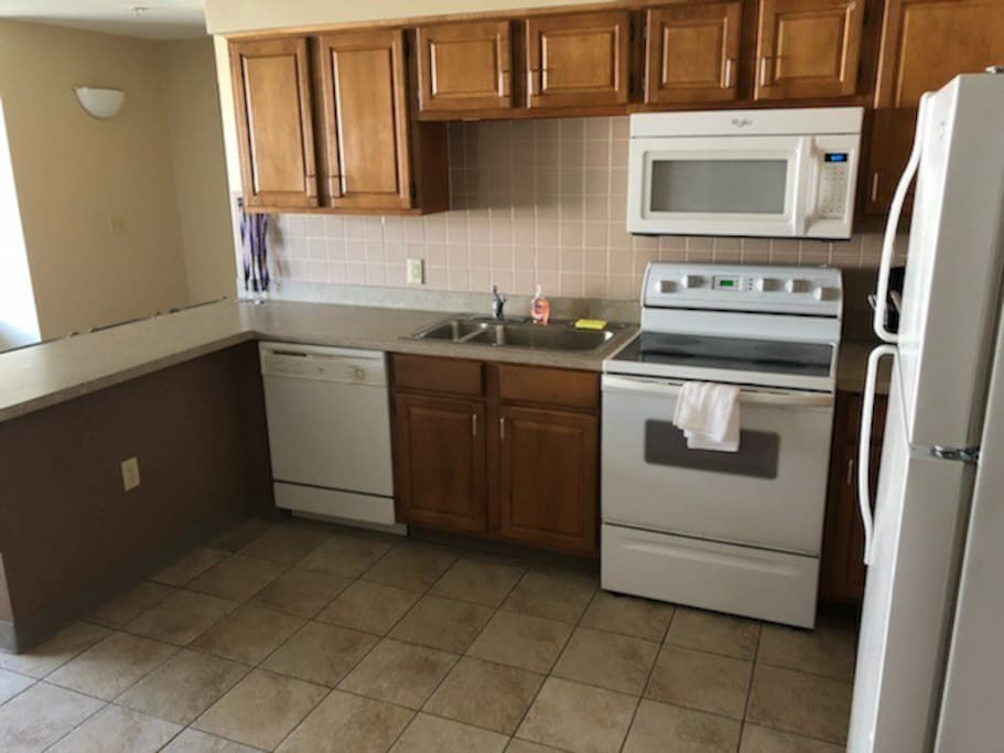 Includes stove, microwave, dishwasher, and full sized refrigerator