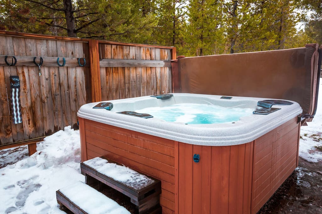 Enjoy the privacy of our hot tub under the stars surrounded by trees and are cedar fence. The hot tub is approximately 60 feet from the back slider.