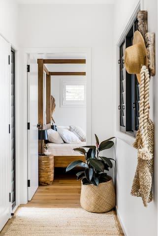 Through hallway into main bedroom