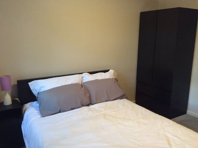 Room with double bed in Woden, Canberra