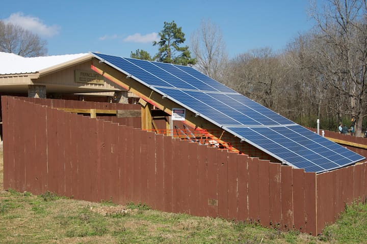18 solar panels, 250W each serve to power the building.