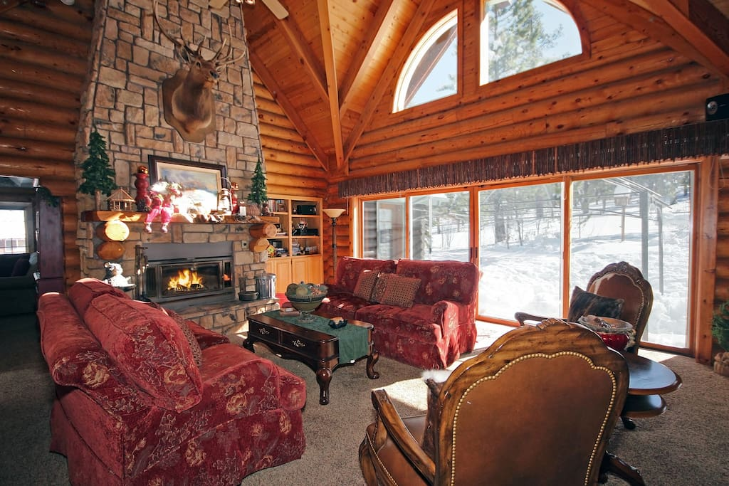 Large living room with a huge fireplace