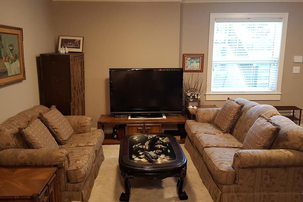 """Living room with 52"""" flat TV."""