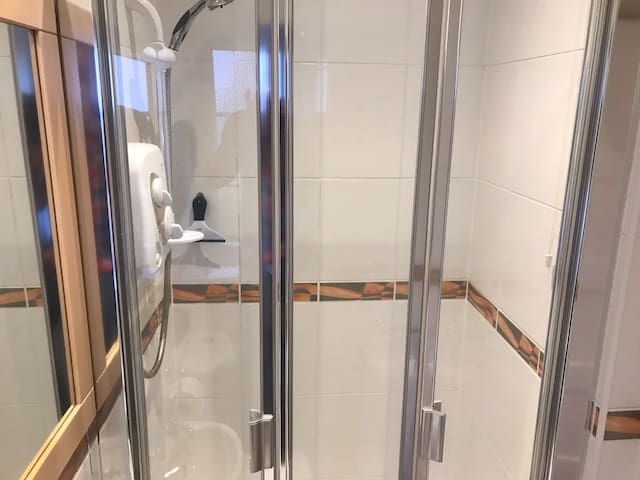 Spacious shower with lashings of hot water and white fluffy towels.
