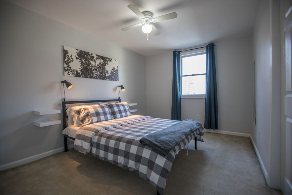 The Master bedroom is spacious and has excellent windows views of the downtown area
