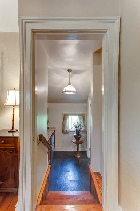 A few steps lead down to the kitchenette and full bathroom.