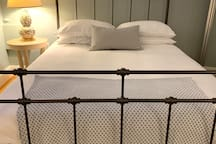 Thick, pure cotton linens, down and feather duvet, memory foam. Sleeps like a dream!